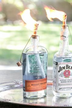 DIY tiki torches using recycled wine and liquor bottles