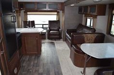 2016 New KEYSTONE BULLET 269RLS Travel Trailer in Michigan MI.Recreational Vehicle, rv, This rear living Bullet travel trailer features two separate entry doors for convenience, and a singled slide for added interior space, plus more!Step inside and find two swivel rockers with an end table between and overhead storage the entire width of the unit. Adjacent to the rockers find a sofa and booth dinette slide. The perfect space for enjoying your meals at, or just relaxing and hanging out. The…