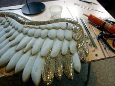 glueing the (mirror) silver feathers to foam