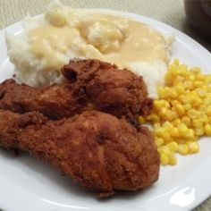 """Fried Chicken with Creamy Gravy ~ Recipe By:Gina """"Seasoned fried chicken is served with a rich gravy made from the pan drippings. It's down home goodness that's definitely not for dieters! Takes some preparation, but is definitely worth it. Gravy Fries, Great Recipes, Favorite Recipes, Chicken Gravy, Chicken Stroganoff, Fried Chicken Recipes, Pan Fried Chicken, Chicken Steak, Food Dishes"""