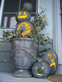 grey jack-o-lanterns--I think spraying an artificial pumpkin with grey stone spray paint would be a great look--have to try it.