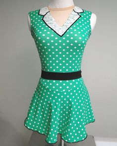 Skating to 50s music, such as Grease? This 50s figure skating dress is made of green and white polka dot fabric, lace collar trimmed in black