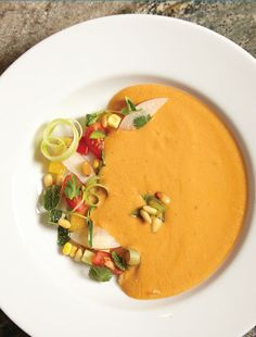 Summer Peach and Heirloom Tomato Gazpacho. This recipe is perfect for a dinner with friends.
