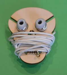 This fun earphone earbud tidy allows you to store your earphones with out tangled wires. Skull shaped with a smoking grin. The each tidy is 8cm tall