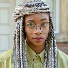 glasses, gray braids, pastel
