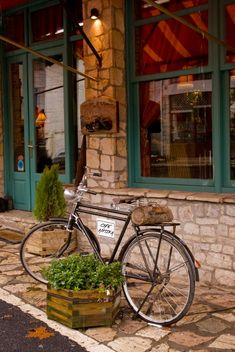 Vintage bicycle on cobblestone street.