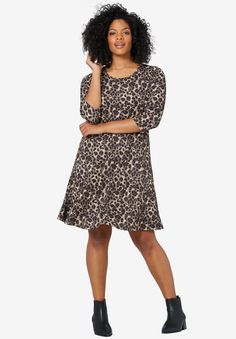 "A-line dress with scoop neckline. 3/4 sleeves. Front and back princess seams. Straight bottom hem.Fabric: 95% polyester/5% spandex ITY knitMachine wash coldImportedMeasurementsLength: Just above knee38"", center back"