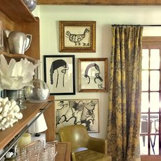 Fabulous dining room in Lauren Liess' home. Love that she put up the kids' art masterpieces and framed them so elegantly.