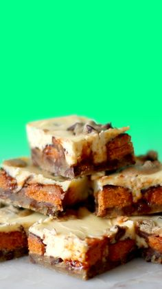"""Recipe with video instructions: There is no such thing as """"too much"""" with these cookie dough-based bars made with Butterfinger and cheesecake. Fun Desserts, Delicious Desserts, Dessert Recipes, Yummy Food, Dessert Ideas, Cupcakes, Cupcake Cakes, Bundt Cakes, Butterfinger Bars Recipe"""