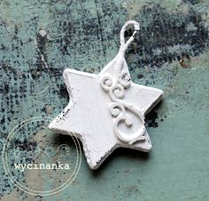 Wooden star decorate by chipboard fluorish.