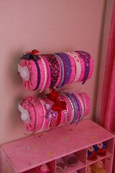 Headband Storage - paper towel holder with paper towels covered with fabric.  Yes, paper towels.