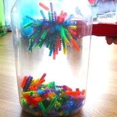 Discovery bottles for kids. This site has a list of ideas for various fillers for these science and sensory discovery bottles. This one is filled with cut up pipe cleaners. Use magnetic wands to draw the pipe cleaners up the side of the bottle. Preschool Science, Craft Activities For Kids, Preschool Activities, Projects For Kids, Science Fun, Magnets Science, Science Ideas, Science Experiments For Toddlers, Science Bottle