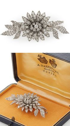 A floral diamond set brooch, modelled as a flower in bloom, set throughout with old round, rose and eight cut diamonds, in unmarked white metal, in a fitted box by A TAZZETTI & C...TORINO, Width: 60mm