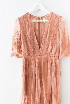 - Gorgeous embroidered lace maxi dress - Plunging V neckline - Scalloped trim - Side slits - Zipper back - Non-stretch lace - Lined neckline and shorts underneath - 100% Polyester - Imported