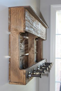 Repurposed pallet coat rack - preeetty sure I could do this.