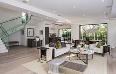 The built in bar of this living space accentuates the great outdoor area that this room opens up to through pocket doors. 6242 Drexel Ave | Beverly Grove