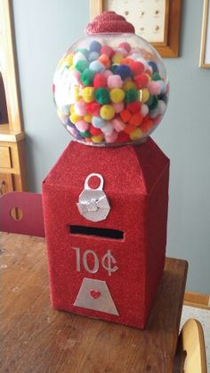 Valentine's Card Box. Used pom poms instead of actually gum balls. Much lighter.