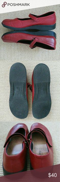 Charming, Red Arcopedico MaryJanes Cute, comfortable, bright red MaryJanes. Lightweight, well made. These shoes were returned to me because a buyer thought they looked dirty inside but that is not the case. Arcopedico insoles have a darkened, antique look. These are in very good, used condition. The soles are essentially pristine. They are true to size. I love them but I have too many red shoes, so these are up for grabs to a lucky Sz 9. Arcopedico Shoes Flats & Loafers