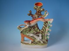 Incredible Staffordshire leaping whippet & hare spill vase