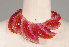 Coppola e Toppo Graduating Leaf Collar Italian, 1960s Multifaceted plastic beads in pale and fuschia pink, and orange, 3 x 16 inches, marked: Made in Italy/Coppola e Toppo. Excellent condition.  Sold for $1,320 (2005)