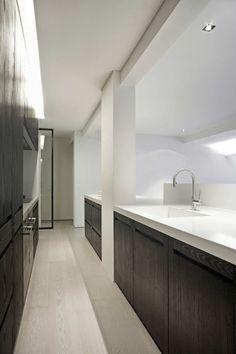 the balance… whitewash floors, white walls, black cabinets with white benchtop.