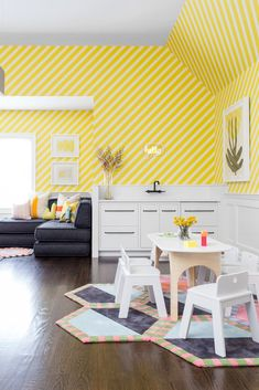 A playroom in Rumson, New Jersey, designed by Chango & Co. features a kitchenette and bold, striped yellow wallpaper. The table and chairs are from Land of Nod, and underfoot is a rug from Kinder MODERN. #dwell #howtodesignakidsroom #kidsroom #moderndesign #howto #diy #designtips Modern Playroom, Playroom Ideas, Yellow Playroom, Study Rooms, Play Rooms, Game Rooms, Study Space, Study Room Design, Design Projects