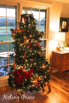 Tight budget this holiday season? When we didn't have a budget left for a tree, I had to get creative. This Christmas Tree Ladder was my solution! Ladder Christmas Tree, Upside Down Christmas Tree, Unique Christmas Trees, Alternative Christmas Tree, Christmas On A Budget, Christmas Villages, Merry Little Christmas, All Things Christmas, Christmas Home