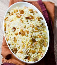 Saffron Rice with Golden Raisins and Pine Nuts | http://homemaderecipes.com/cooking-102/seasonalholiday-recipes/18-christmas-side-dishes/