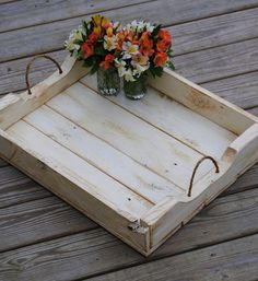Large Rustic Serving tray with rope handles handcrafted with reclaimed wood from the Sebago Lakes Region of Maine.  Reclaimed wooden pallets painted in your choice of color and a distressed finish and rope added to use as handles for a rustic charm. This tray is large and makes for a gorgeous centerpiece and so much more! Made to Order.  ~Measures: approx. 25 x 18 1/4 height: approx. 4 1/4 ~Reclaimed wooden pallets painted in your choice of color and a distressed finish ~2 Rope handles…