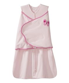 Replacing traditional loose blankets with a safeguarded zip-up silhouette and adjustable swaddle wrap, this darling HALO SleepSack Swaddle fits over pajamas to provide ventilation and warmth. Its roomy design allows for lower body movement, while an inverted zipper simplifies diaper duty. A portion of every sale goes to support SIDS research groups.