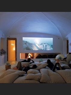 Play Room/ Theater Room.... keep lots of oversized pillows stored and use a projector instead of a flat screen.