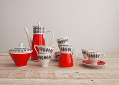Vintage 1950s Coffee Set - 50s Red & White Mid Century Porcelain Set - Atomic DDR German Complete Tea Coffee Set by goldencranehome on Etsy https://www.etsy.com/listing/212683650/vintage-1950s-coffee-set-50s-red-white