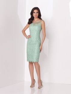 Sleeveless lace knee-length sheath, illusion bateau neckline over sweetheart bodice with scattered hand-beading, illusion back bodice, scalloped hemline with center back slit, suitable as a dress to wear to a wedding. Jeweled Occasions earring style Kristina and bracelet style Beverly sold separately. Sizes: 4 – 20 Colors: Mint