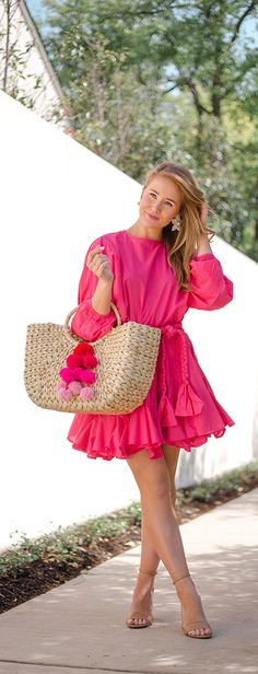 pink party dress perfection || LonestarSouthern.com #pink #partydress #pompom #strawbag #samedelman