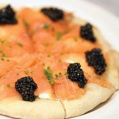 Pizza with smoked salmon and caviar