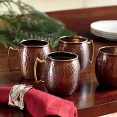 Russet Mule Mugs | The signature vessel for serving classic Moscow Mules, an antiqued solid-copper mug can also be used for beer and other frosty libations. Lined in nickel with a brass handle; available in 16-ounce and 24-ounce sizes. Set of four.