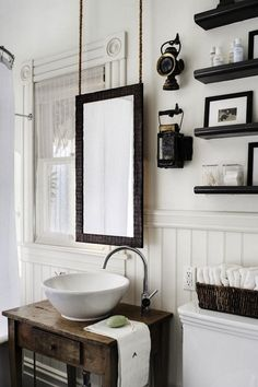 Bathroom. Window in the way? No problem, hang the mirror from the ceiling. Genius!