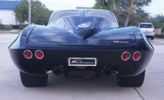 """The 1963 Corvette V7 twin-turbo show car 2015. Inspired by his mid-engine Ford GT, Mark Harlan pondered the question """"what if GM had created a mid-engine version of the second-generation Corvette to run at Le Mans."""" His answer was the 1963 Corvette V7 twin-turbo that will surely polarize enthusiasts. Harlan's creation will cross the stage in Ft Lauderdale as part of Auctions US sale. http://blog.hemmings.com/index.php/tag/auctions-america/#sthash.b1Snws28.dpuf"""
