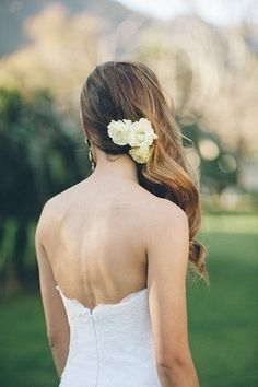 Side swept hair with small fresh flowers for the bride. Love ittt
