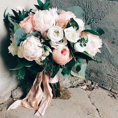 Hottest 7 Spring Wedding Flowers to Rock Your Big Day---Garden style bridal bouquet including Juliet garden roses, white peonies, lisianthus, blushing bride protea, jasmine and eucalyptus.