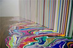 "Ian Davenport,  once the youngest nominee for the Turner Prize, creates his ""syringe art"" by squirting glossy paint onto canvas and allowing gravity to determine the final composition."