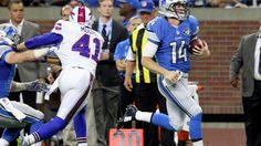 Photo by Jorge Lemus.  Detroit Lions quarterback Jake Rudock (14) runs the ball during the second half…