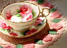 (not so) shabby chic teacup and saucer on a vintage pink and green doily