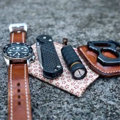 Typical carry consisting of a watch, knife, light, knuck and a handkerchief