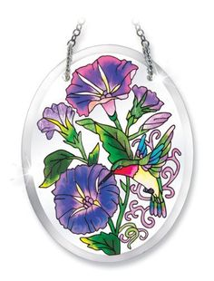 Amia 6173 Morning Glories and Hummingbird Design Hand-Painted Glass Suncatcher, 5-1/4-Inch by 4-Inch by Amia. $12.00. Includes chain. Beveled, hand-painted glass. Comes boxed, makes for a great gift. Amia Glass is a top selling line of handpainted glass decor. Known for tying in rich colors and excellent designs, Amia has a full line of handpainted glass pieces to satisfy your decor needs. Items in the line range from suncatchers, window decor panels, vases, vot...