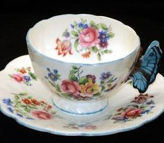 Mine is just like this except that the handle and edges are green instead of blue and mine is in perfect condition. AYNSLEY BUTTERFLY HANDLE Green TRIM TEA CUP AND SAUCER