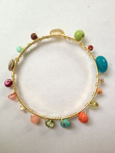 Multi bead multi colors gold bangle by WiredJewelrybyJenna on Etsy, $12.00