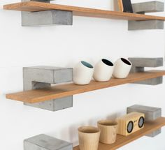 Wood & Concrete Shelf by Sue Pryke; a British Homeware designer. They have a brutalist element with the chunky concrete brackets contrasting against the smooth Oak shelves.