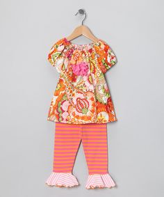 Stripes, flowers and flair—there's no limit to the mixing and matching possibilities of this super-sweet set. With the stretchy waist on the pants and the tunic's gathered neckline and fluffy rosette, this ensemble can liven up any day simply and beautifully.Includes tunic and capri pants100% cottonMachine wash; hang dr...