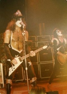 KISS playing 'Firehouse' Dressed To Kill/Alive World Tour 1975 - Paul In His Usual Firemans Helmet During The Song